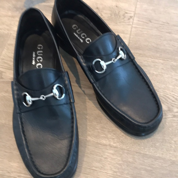 Men\u2019s classic black Gucci loafers.